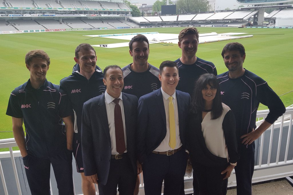 Members of Middlesex CCC with the team from Barclays